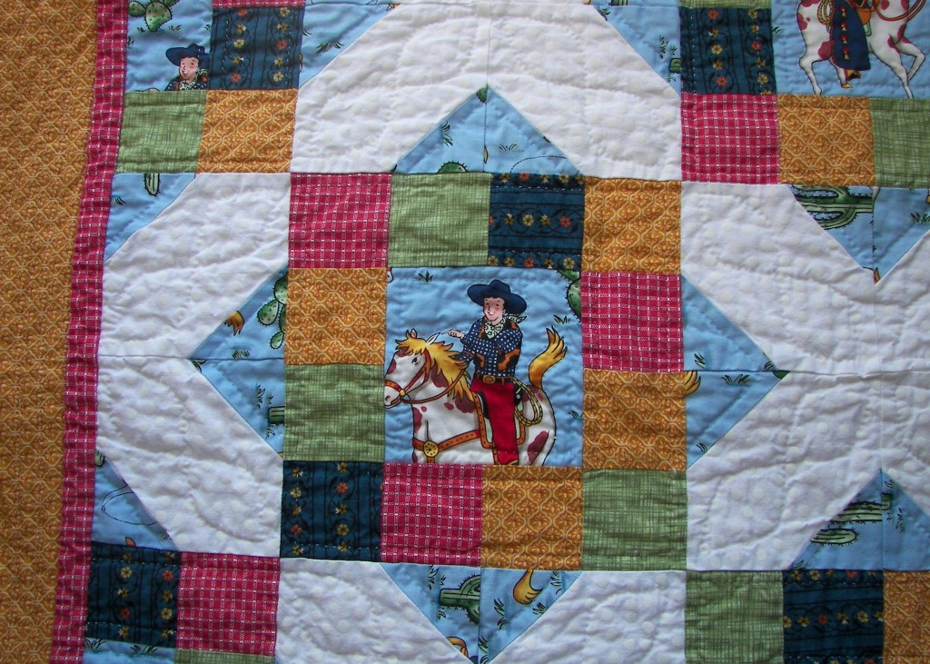 Framed cowboys hand quilted blanket